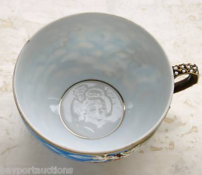 Japanese tea cup with face in bottom