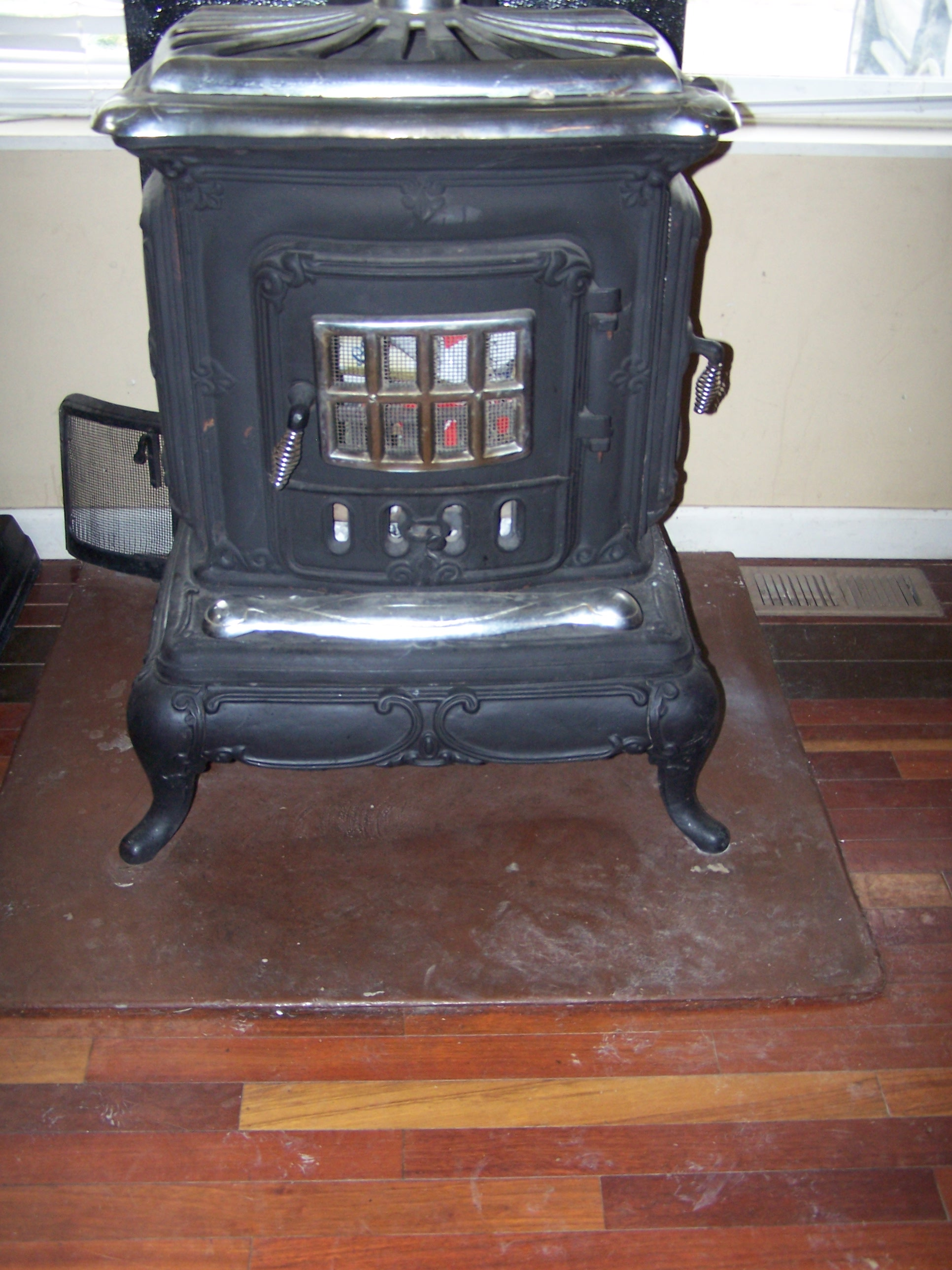 Antique Cast Iron Wood Burning Stove With Chrome Lid Antique