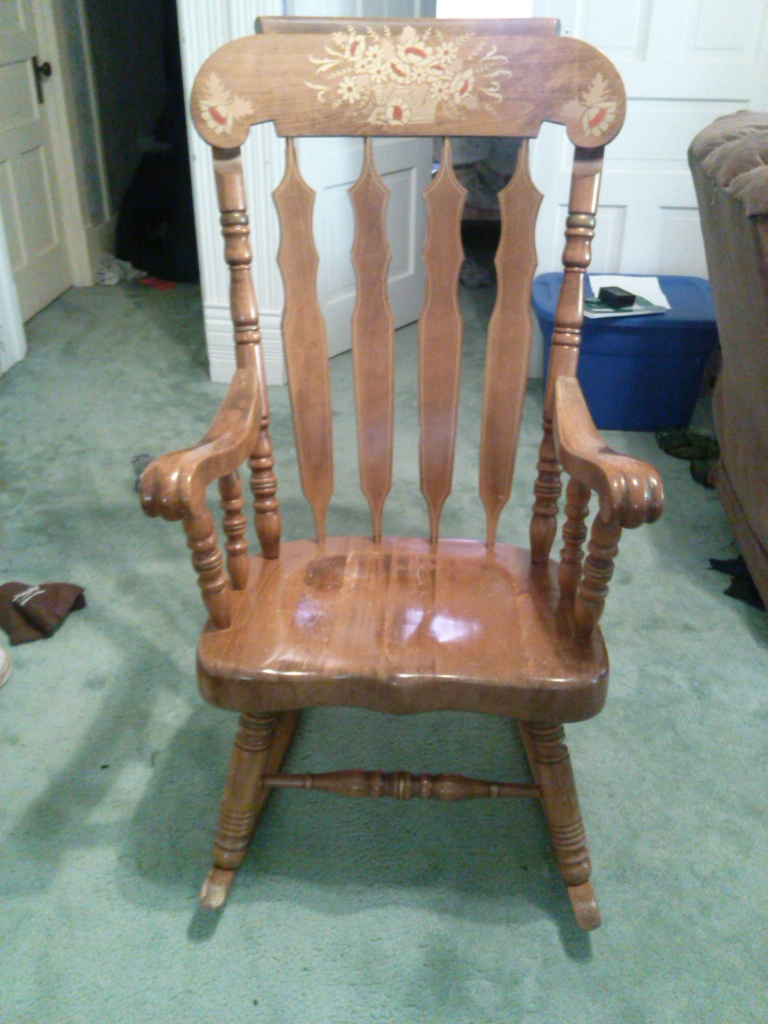 Antique Rocking Chair With Floral Scene On Top Of Front Of