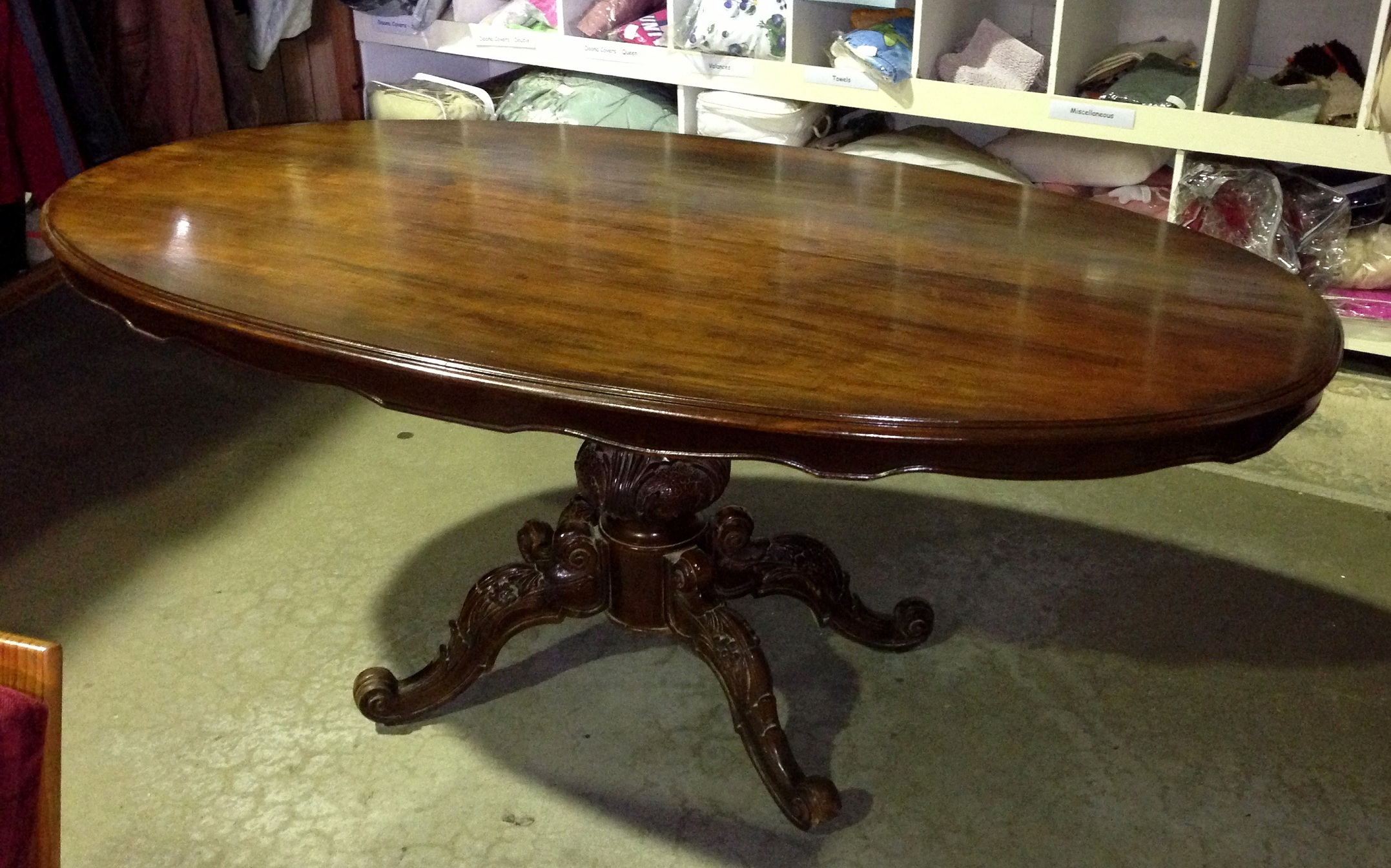Oval Shaped Dining Table With Apron And Pedestal Base With Carved Legs And  Feet