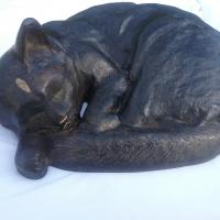 Cast Iron Sleeping Cat doorstop with green eyes