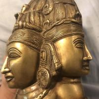 Gold or bronze statue right side