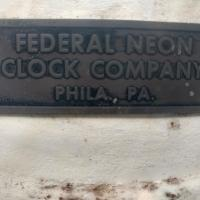 Federal neon clock company tag