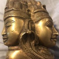 Gold or bronze statue left side