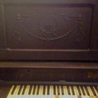 Scrollwork on Weaver upright piano